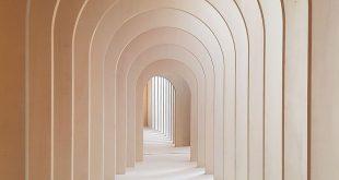 Light peach tan arches in hallway minimal architecture minimal photography